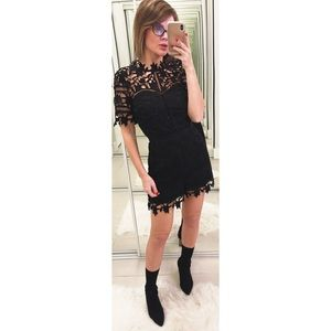 Adelyn Rae Illusion Lace Romper in Black